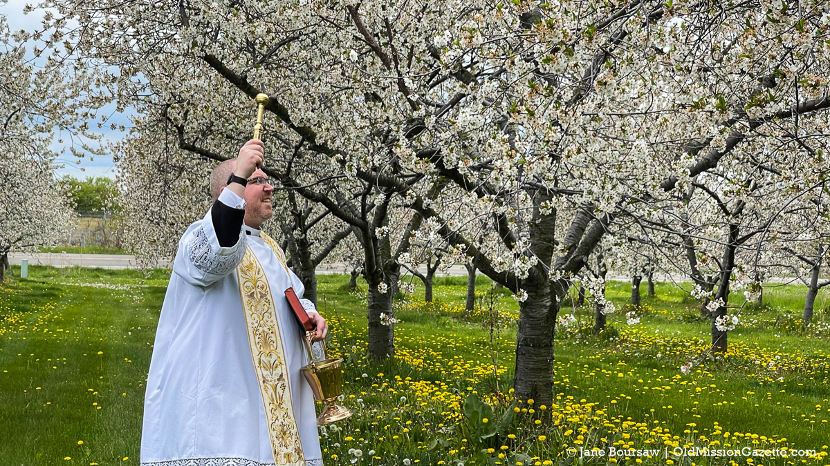 Father Rexroat performs the Blessing of the Blossoms on the Old Mission Peninsula | Jane Boursaw Photo