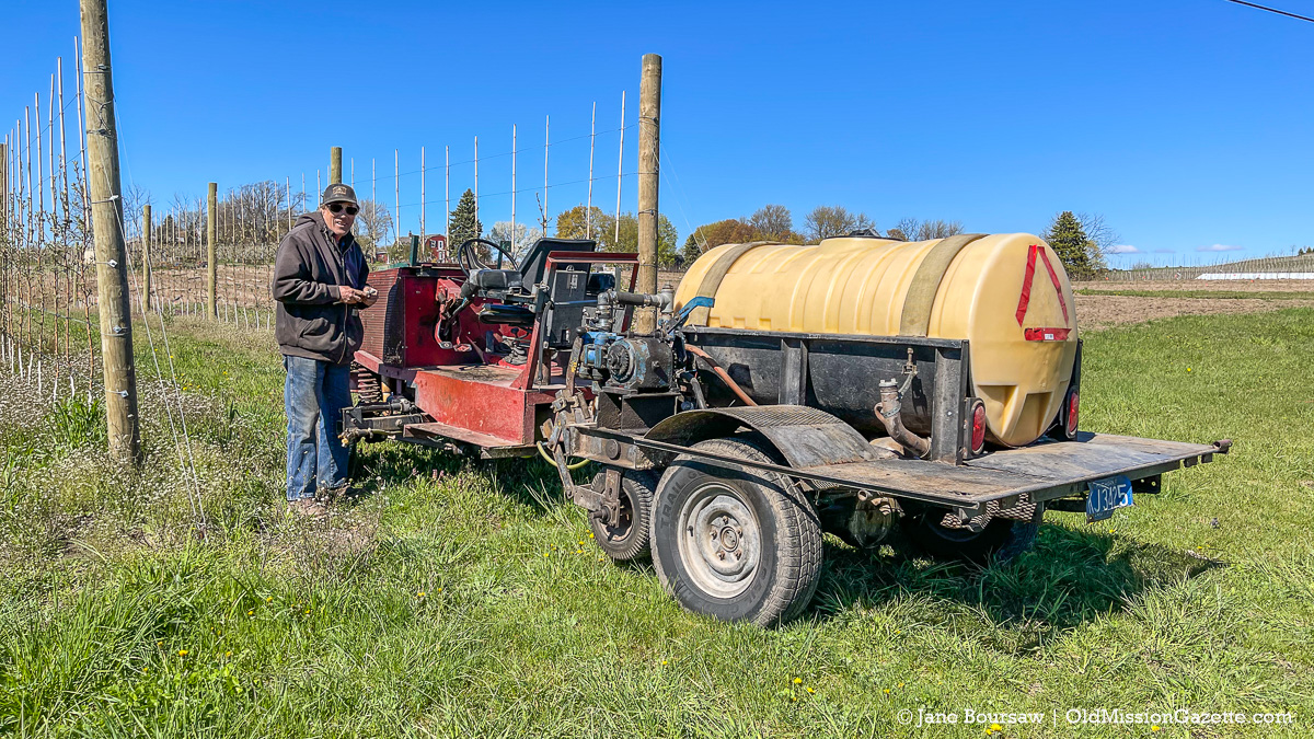 Dean Johnson with a weedsprayer at his farm on the corner of Kroupa Road and Center Road | Jane Boursaw Photo
