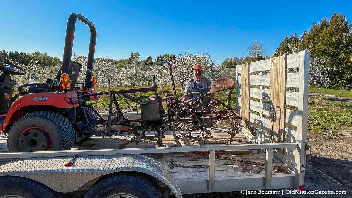 "Dan ""Farmer Dan"" Tuller with his corn planter in Ward Johnson's orchard | Jane Boursaw Photo"
