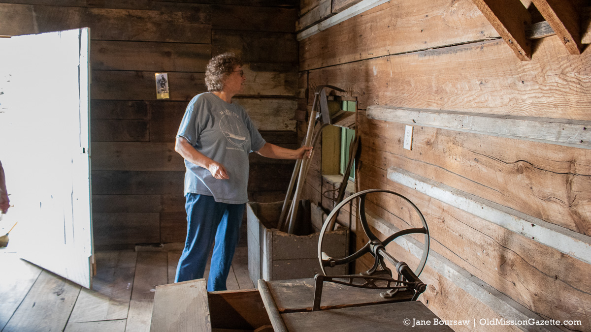 Laura Johnson organizes the carriage house at the Historic Dougherty House in Old Mission, Michigan | Jane Boursaw Photo