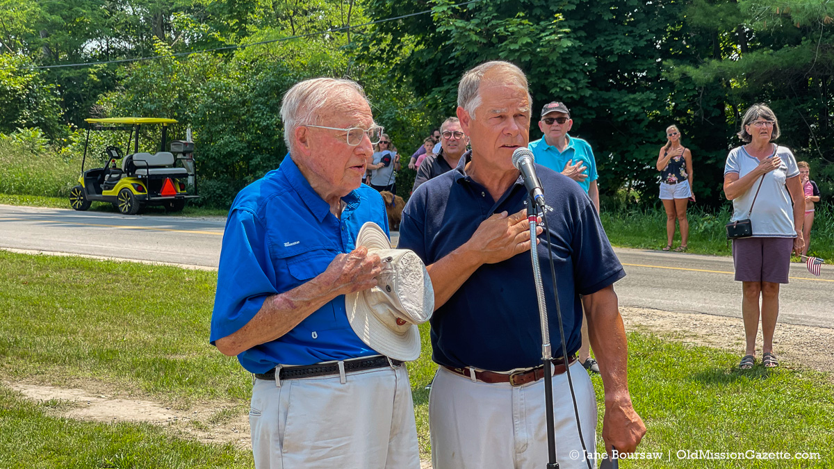 Veterans Bernie Oakes and Tom Petzold led the Pledge of Allegiance at the Legion Hall; A Patriotic Walk Around Old Mission on July 4, 2021   Jane Boursaw Photo