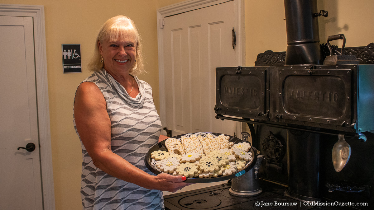 Old Mission Women's Club President Janis Haine with her gourmet cookies | Jane Boursaw Photo