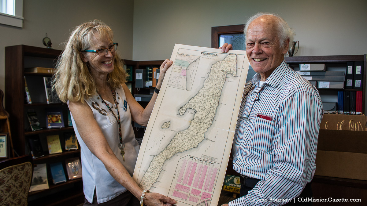 Mary Morgan and Tim Carroll with a vintage Old Mission Peninsula map at Peninsula Community Library's History Room; Harvesting History event | Jane Boursaw Photo