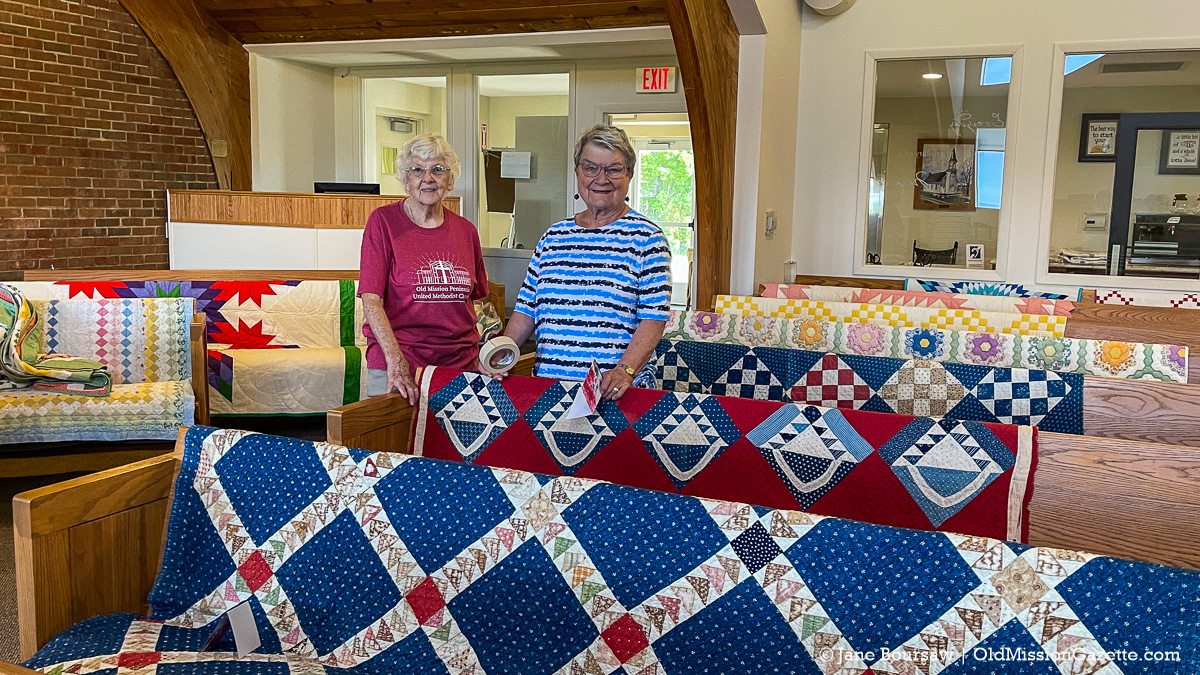 Georgia Holman and Judy Weaver at the Vintage Quilt Display at Old Mission Peninsula United Methodist Church; Harvesting History event | Jane Boursaw Photo