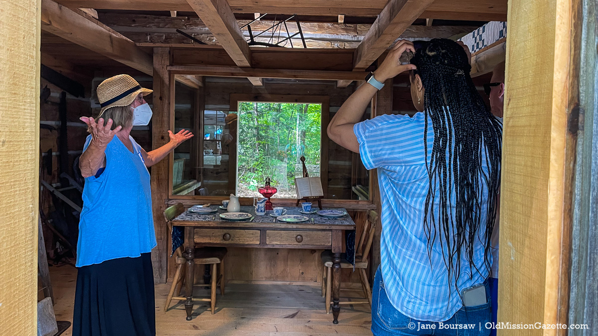 Phyllis Cooley (Jane's cousin) gives a tour of the Hessler Log Home at Lighthouse Park; Harvesting History event | Jane Boursaw Photo