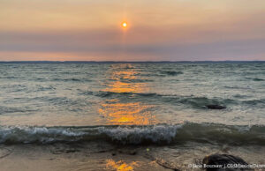 Sunset over West Bay at Mission Point Lighthouse Beach on the Old Mission Peninsula | Jane Boursaw Photo