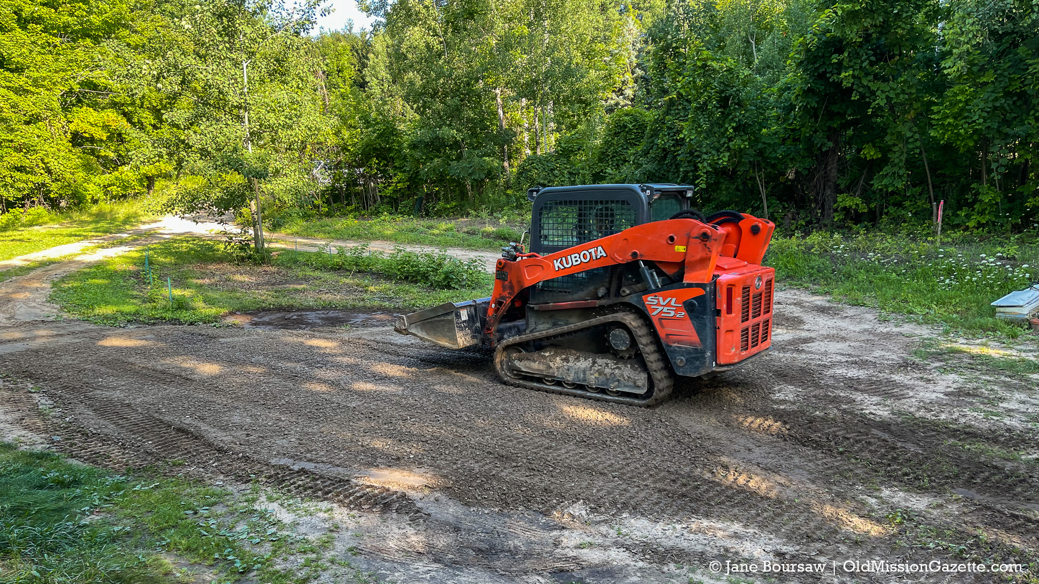 Jane's World - Nate McManus, owner of Oliver and Co., fixing Lake Boursaw in Tim and Jane's driveway | Jane Boursaw Photo