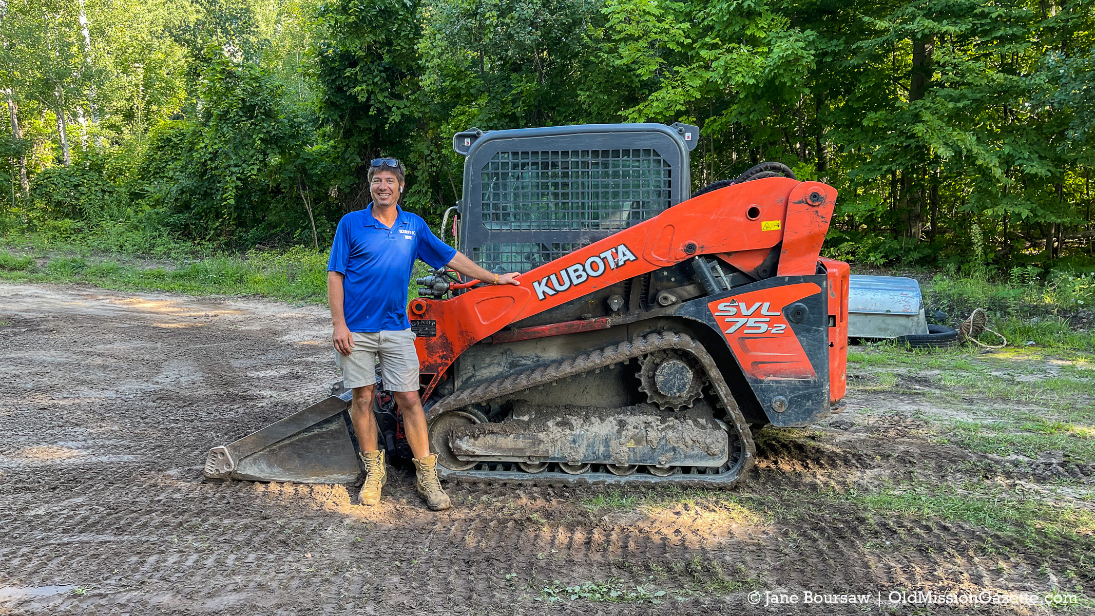 Nate McManus, owner of Oliver and Co., fixing drainage issues at Tim and Jane's house | Jane Boursaw Photo