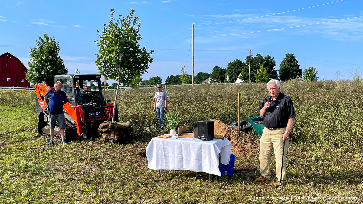 Jim Hall, a member of the Old Mission Peninsula Historical Society Tree Planting Committee, makes remarks at the Covid Memorial Tree Planting at Peninsula Community Library | Jane Boursaw Photo