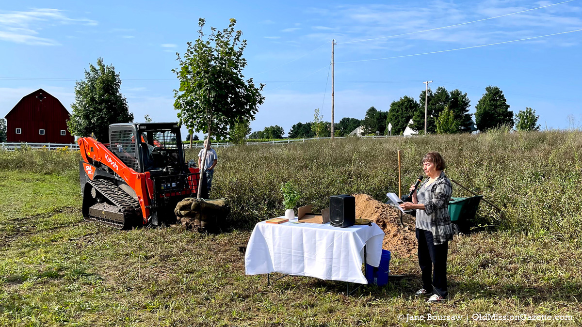Nikki Sobkowski, President of the Old Mission Peninsula Historical Society, reads a poem at the Covid Memorial Tree Planting | Jane Boursaw Photo