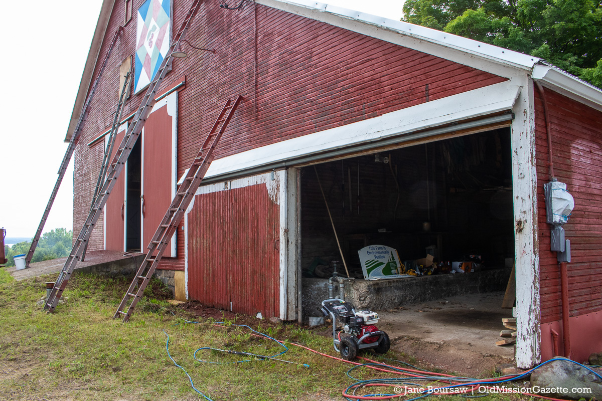 Johnson Farms Barn on Center Road gets power-washed and prepped for painting   Jane Boursaw Photo